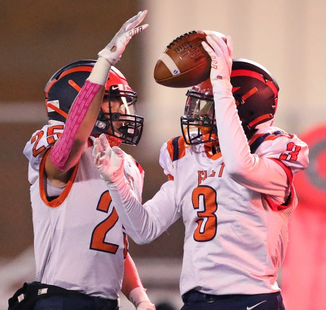Ellet receiver Devin Huwig, right, celebrates with running back Dustin Richmond after a touchdown reception during the second half of a football game against Firestone at Ellet High School, Friday, Oct. 2, 2020, in Akron, Ohio. [Jeff Lange/Beacon Journal]