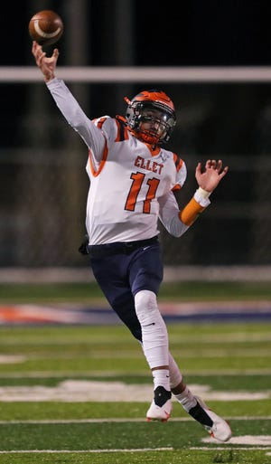 Ellet quarterback Jordan Williams throws on the run during the first half Friday against Firestone at Ellet High School.