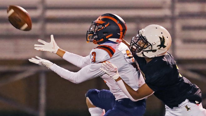 Ellet receiver Devin Huwig hauls in a pass for first down against Firestone's Alex Knight during the second half of a football game at Ellet High School, Friday, Oct. 2, 2020, in Akron, Ohio. [Jeff Lange/Beacon Journal]