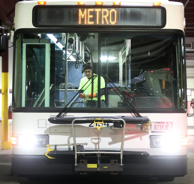Jerry Lenox, a Metro vehicle maintenance worker, starts a deep clean on a bus in April 2020 at the Metro RTA facility on Kenmore Boulevard in Akron.