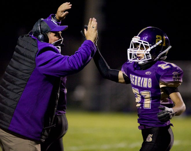 Sebring McKinley head coach Matt Seidel celebrates with Justin Belt after the Trojans recorded a safety in a Mahoning Valley Athletic Conference game against Western Reserve at Schaefer-Davies Stadium Friday, October 2, 2020.