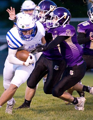 Sebring McKinley's Matt Byrd (69) and Zach Ruzek combine to tackle Western Reserve's David Altiere in a Mahoning Valley Athletic Conference game at Schaefer-Davies Stadium Friday, October 2, 2020.