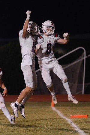 CB East players Tommy Day and Quinn Moody celebrate after a touchdown on Friday Oct. 2, 2020. CB East won 28-21.