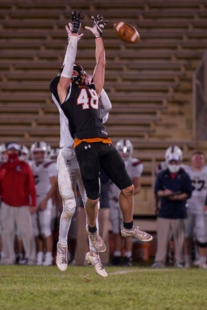 Pennsbury receiver Chris Terry jumps up for a pass on Friday in the Falcons' 28-21 season-opening loss to Central Bucks East.