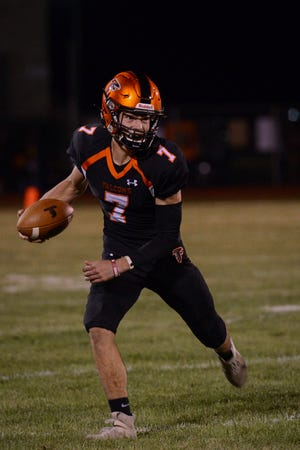 Pennsbury quarterback Patrick Kirk looks to make a play during Central Bucks East's 28-21 win Friday.