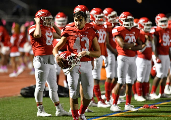Rancocas Valley's Vincenzo Soares checks the sideline during Friday's game against visiting Moorestown. The Red Devils blanked the Quakers, 40-0. Oct. 2, 2020.