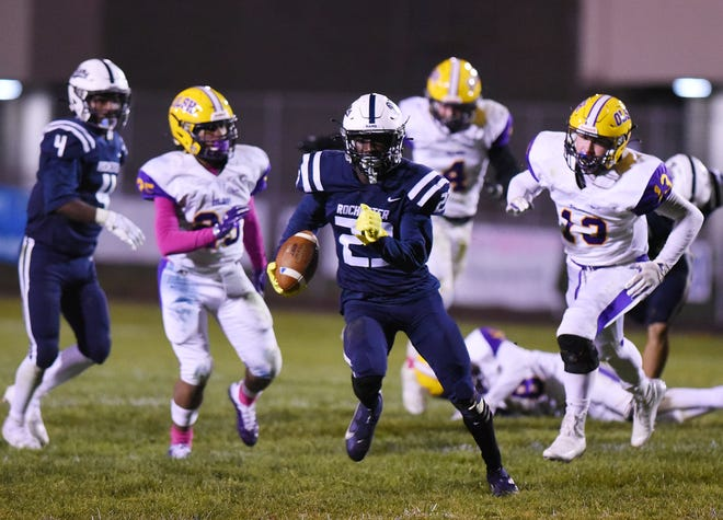 Rochester's Rashawn Reid breaks away from OLSH for a touchdown earlier this season. Reid ran for a score and threw for another against  Shenango on Friday.