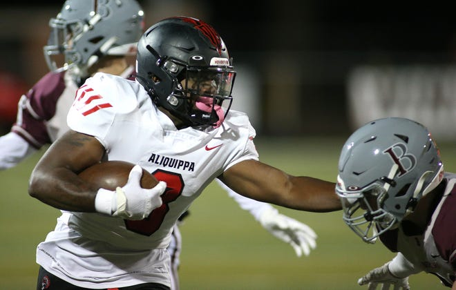 Aliquippa's Karl Mcbride, Jr. (3) stiff arms Beaver's Marco Mamone during their game last week. McBride and the Quips host Chartiers Valley Friday night in a battle for first place in the Parkway Conference.