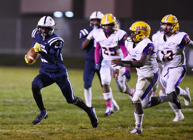 Rochester's Rashawn Reid breaks away from OLSH for his sixth touchdown of the game Friday at Rochester Area High School.