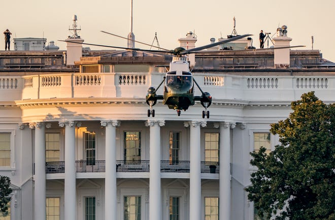 """Marine One lifts off from the White House to carry President Donald Trump to Walter Reed National Military Medical Center on Friday in Bethesda, Md. The White House says Trump will spend a """"few days"""" at the military hospital after contracting COVID-19."""