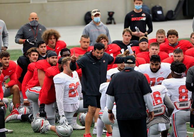 Ohio State Buckeyes head coach Ryan Day talks to his team before the start of practice at Ohio Stadium in Columbus, Ohio on October 3, 2020.