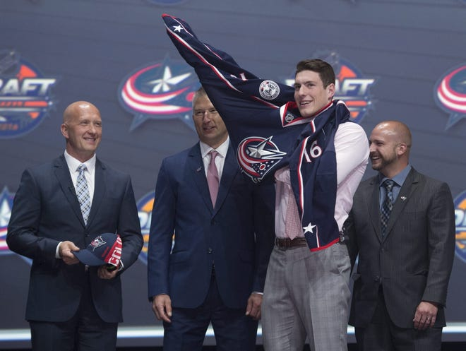 Pierre-Luc Dubois, now the Blue Jackets' top center, first put on the team's sweater as the third overall pick of the 2016 NHL draft in Buffalo, N.Y. The 2020 draft will be held entirely online, without a draft stage, team tables or the usual photos of prospects and their new team's front office. [Nathan Denette/The Canadian Press]
