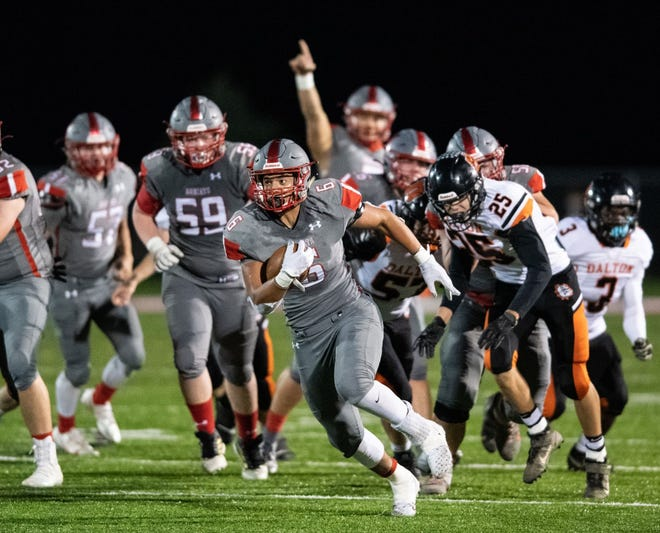 Norwayne's Ameer Cunningham burst free for a long touchdown run against Dalton as Nate Bitskay celebrates in the background.
