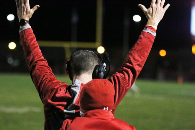 DCG head football coach Scott Heitland rejoices after the Mustang defense intercepts ADM to seal the win on Friday, Oct. 2 in Grimes.