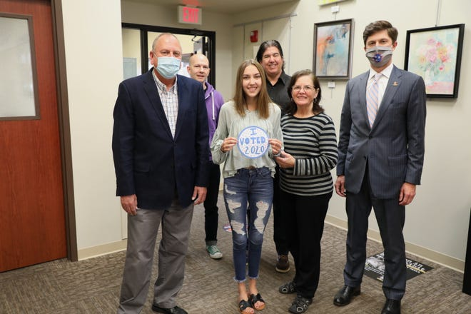 "Spring Hill High School junior Penelope Richards and her parents visit City Hall for a photo op with Mayor Chaz Molder, right, Maury County Election Commission Administrator of Elections Todd Baxter, left, as well as Columbia Arts Council member Frank Cole. Richards was the winner of a recent ""I voted"" sticker contest, with the winning design distributed during the upcoming Nov. 3 election. (Courtesy photo/City of Columbia)"