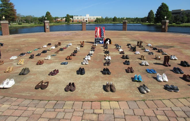 Mental health advocates staged the Empty Shoe Memorial for Suicide Awareness display at Flagler Beach to raise awareness for mental health needs and resources.