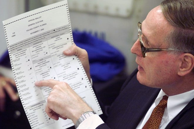 County Judge Michael McDermott points to a mismarked ballot during the 2000 election count.