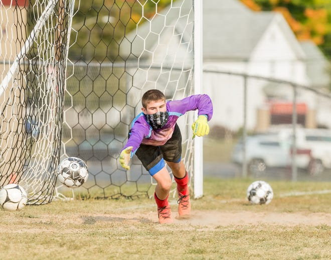 Maddox Schwartz makes a diving save during practice for Canisteo-Greenwood.