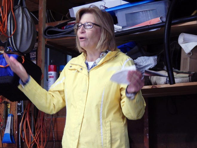 Congressional candidate Rita Hart speaks Saturday inside a garage in Burlington. Hart is running for congress for what would be Dave Loebsack's vacated seat in Iowa's 2nd congressional district.
