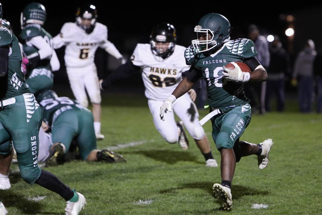 West Burlington High School's Travain Donaldson (18) on his way to scoring a touchdown during the first half of their home game against Central Lee High School Oct. 2 at West Burlington's Bill Nelson Field.