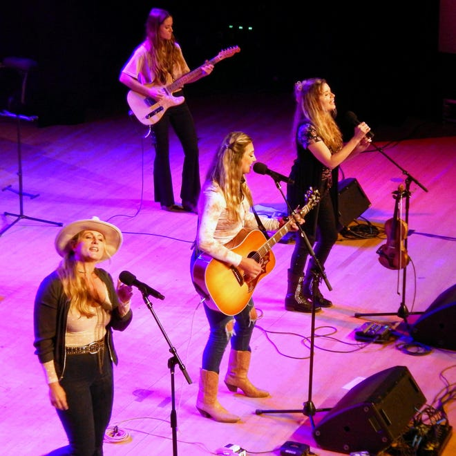 Singers Nicole Witt, Ashley Gearing and Andrea Young are the Nashville-based trio called Farewell Angelina, and they made the Burlington Civic Music audience happy with their live concert Friday at Memorial Auditorium in Burlington. Playing guitar in the background is Andrea Benz of Switzerland.