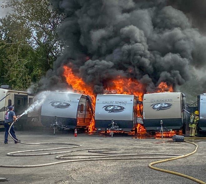 Jacksonville firefighters battled a blaze that destroyed several recreational vehicles Saturday afternoon in the 7500 block of Blanding Boulevard on the city's Westside.