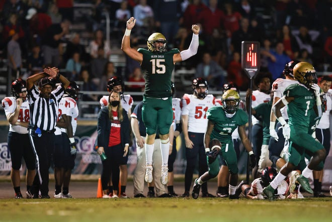 Fleming Island middle linebacker Alex Maier (15) celebrates a defensive stand late in the fourth quarter to seal the victory over Creekside on Friday night.
