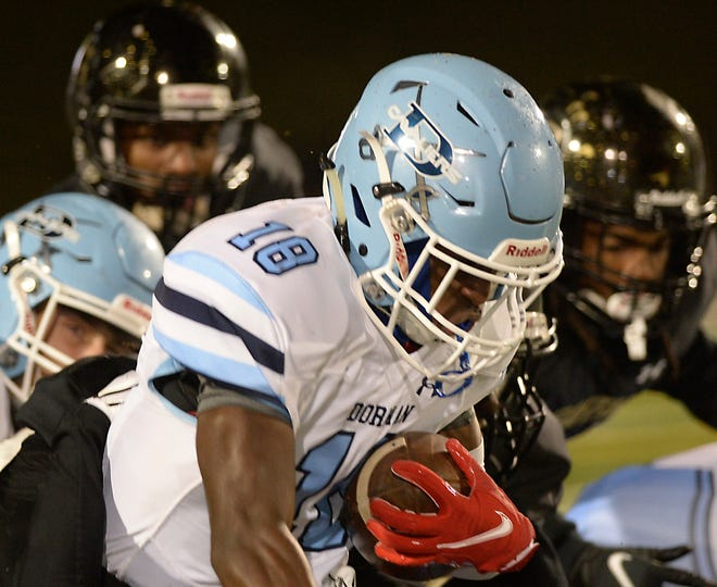 Gaffney played Dorman in high school football at Gaffney High School on Oct. 2, 2020. Dorman's D.J. Porter (18) with the ball on a play.