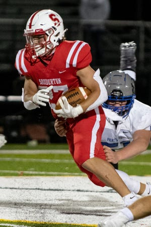 Souderton running back Brayden Porter runs the ball as Quakertown defensive lineman Fred Retter swoops in for the tackle on Friday, October 2, 2020. Souderton won, 28-23.