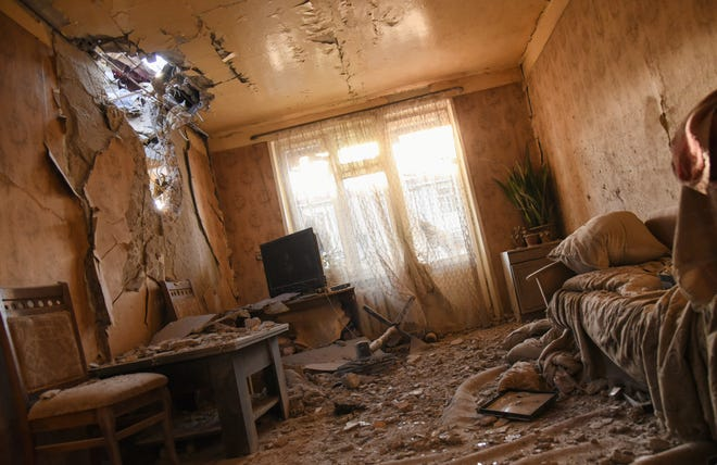 Damages are seen inside an apartment in a residential area after shelling during a military conflict in self-proclaimed Republic of Nagorno-Karabakh, Stepanakert, Azerbaijan, on Saturday. The fighting is the biggest escalation in years in the decades-long dispute over the region, which lies within Azerbaijan but is controlled by local ethnic Armenian forces backed by Armenia.