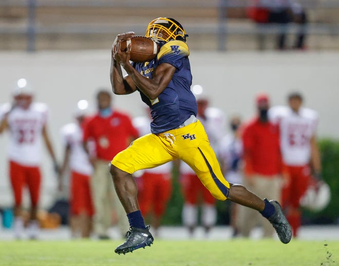 Winter Haven  wide receiver Jakobe Lane pulls in a long pass to score on an 81-yard play against Poinciana no Friday night.