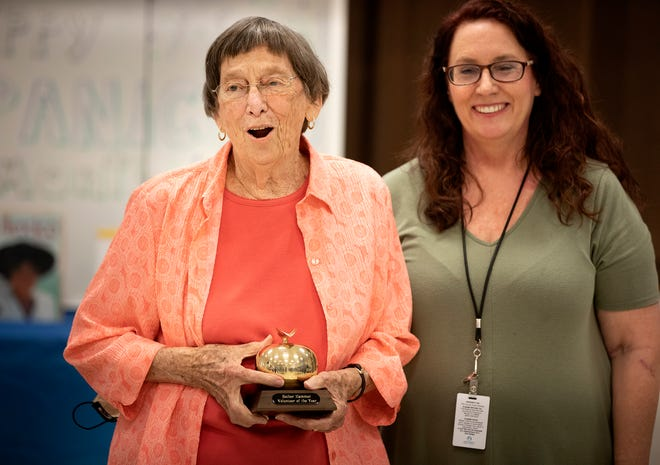 Esther Hammer, left, is presented with the Florida State Volunteer of the Year for Adult Education by teacher Karen Hagerty during a surprise ceremony at the East Area Adult School in Auburndale on Thursday.