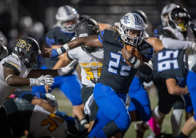 Lakeland Christian running back Dre Hudson (22) eludes the tackle by Fort Meade's Jonathan Berrien (8) to score a touchdown.