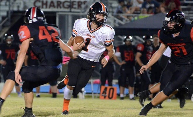Lakeland junior quarterback Mason Martin breaks into the open field during a game at Plant City Strawberry Crest on Friday.