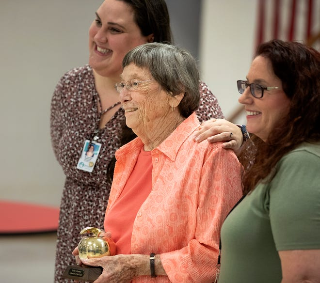 Esther Hammer, center, takes a photo with East Area Administrator Danielle DeConcilio, left, and teacher Karen Hagerty after being presented with the Florida Adult and Community Educators Volunteer of the Year award during a surprise ceremony Thursday.