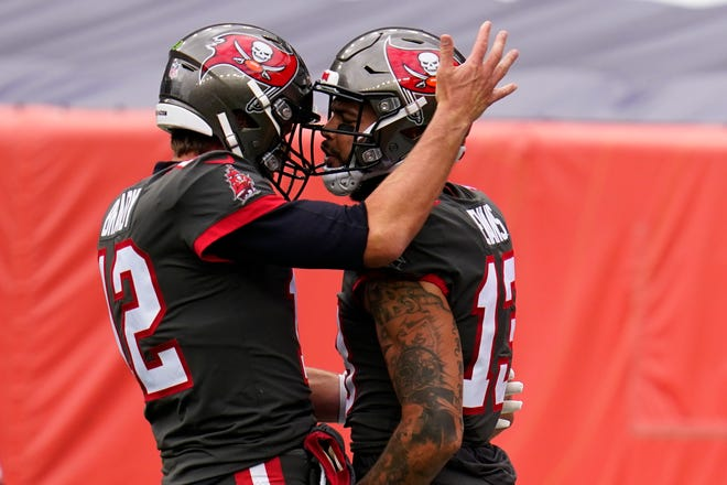 Tampa Bay Buccaneers wide receiver Mike Evans, right, celebrates with quarterback Tom Brady, left, after scoring a touchdown during the first half against the Denver Broncos.