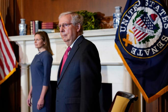 Senate Majority Leader Mitch McConnell, R-Ky., meets with Supreme Court nominee Judge Amy Coney Barrett on Capitol Hill in Washington on Tuesday.