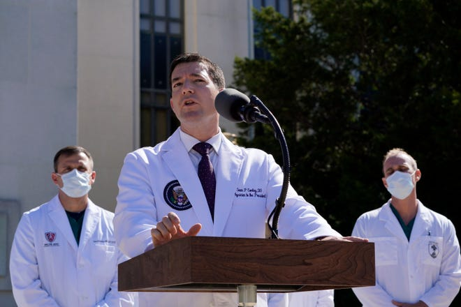 Dr. Sean Conley, physician to President Donald Trump, briefs reporters at Walter Reed National Military Medical Center in Bethesda, Md., on Saturday. Trump was admitted to the hospital after contracting the coronavirus.
