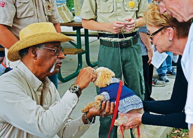 Sammie Harris blesses one of the animals at a previous Pet Festival.