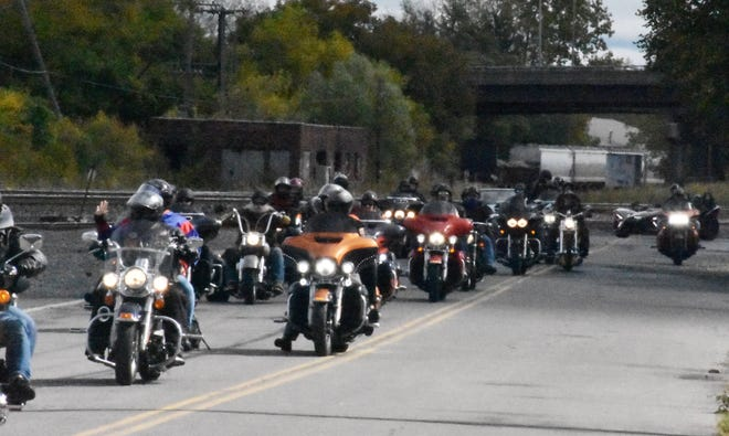 """A group of motorcyclists make their way down Water Street in Utica on Saturday during a """"Back the Blue"""" ride and rally event. About 65 motorcycles were involved in the ride, which started in Deerfield. The event ended Saturday afternoon with a short rally in the parking lot of A&P Master Images in Utica."""
