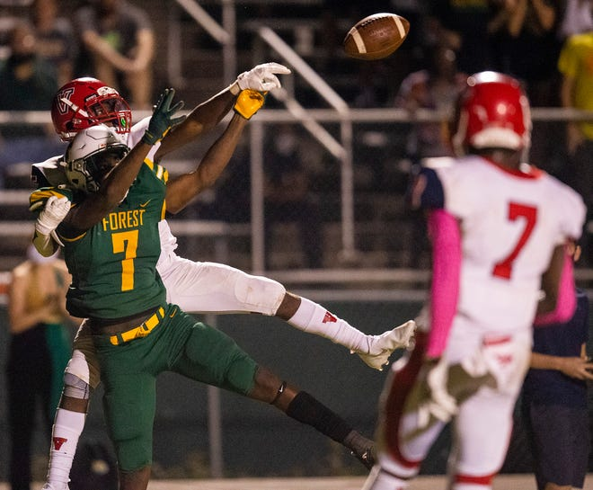 Vanguard's Tyrin Wilson breaks up a last-minute hail mary pass intended for Forest's Izaiah Guy on the final play of the game. The Vanguard Knights defeated the Forest Wildcats 20-14 Friday night.