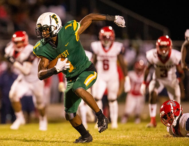 Forest's (1) Jamarrien Burt makes his way to the end zone to tie the game 14-14 after the extra point in the second half. The Vanguard Knights defeated the Forest Wildcats 20-14 Friday night October 2, 2020 in Ocala, FL.  [Doug Engle/Ocala Star Banner]2020