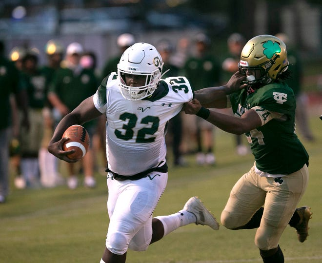 The Villages' Ed Williams holds off Trinity Catholic's Joshua Jenkins to put the Buffalo on the board with the first touchdown of the game. The Celtics made it a close game coming back strong in the second half, but the Buffalo held on for the win, 27-25 at Trinity Catholic Friday night.