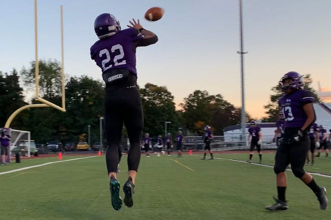 East Stroudsburg South wide receiver Christian Sapp (22) goes up for the grab during warmups for the Cavaliers' game against Pocono Mountain West on Friday, Oct. 2, 2020. ES South won 69-0.