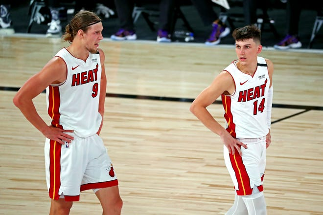 Miami Heat forward Kelly Olynyk (9) talks to guard Tyler Herro (14) during the second quarter against the Los Angeles Lakers in Game 2 of the 2020 NBA Finals at AdventHealth Arena. [Kim Klement-USA TODAY Sports]