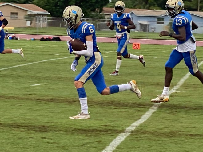 Cardinal Newman's Jacob Lovingshimer (6) warms up before Friday's 28-19 win over Doral Academy. Lovingshimer had a touchdown catch in the win.