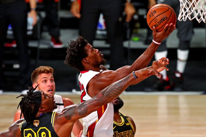Miami Heat forward Jimmy Butler (22) shoots the ball against Los Angeles Lakers center Dwight Howard (39) during the first quarter of Friday's Game 2 of the NBA Finals at AdventHealth Arena. [Kim Klement-USA TODAY Sports]