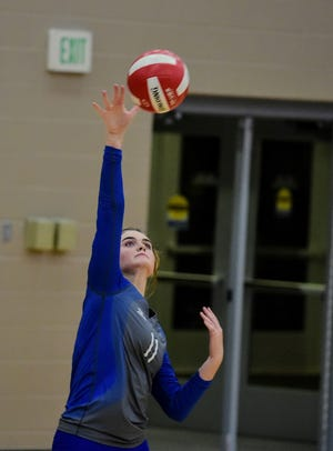 Jayna Kenney serves the ball during a road battle against Gilbert.