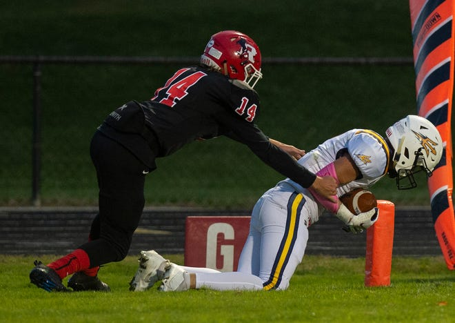 Tallmadge's Seth Yacobucci dives into in the end zone ahead of Kent Roosevelt's Dillinger Sherwood during the Blue Deviles' 26-16 win at Roosevelt Oct. 2.