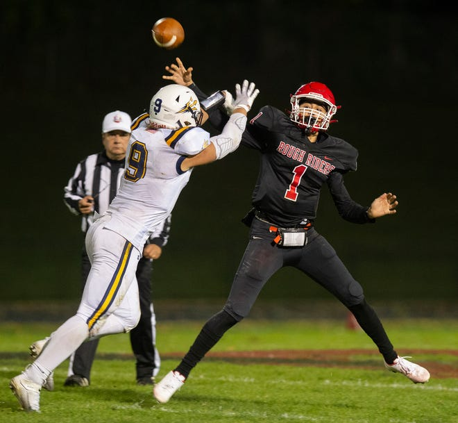 Kent Roosevelt hosted Tallmadge for the Rough Riders first home game of the season, with the Blue Devils winning 26-16.  Quarterback Kristian Daewyler gets pressure from defender Nate Amato.